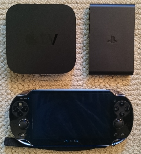 A size comparison of the PS TV (top left) with my 2012 Apple TV (top right) and my regular PS Vita.